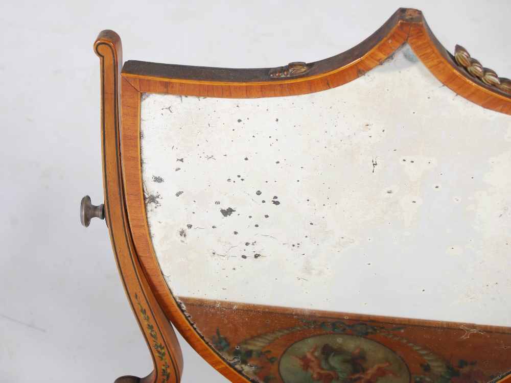 Lot 15 - A 19th century painted satinwood dressing table mirror, the shield shaped mirror plate within shaped