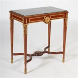 Lot 106 - A late 19th/early 20th century French Empire style mahogany and gilt metal mounted side table, the