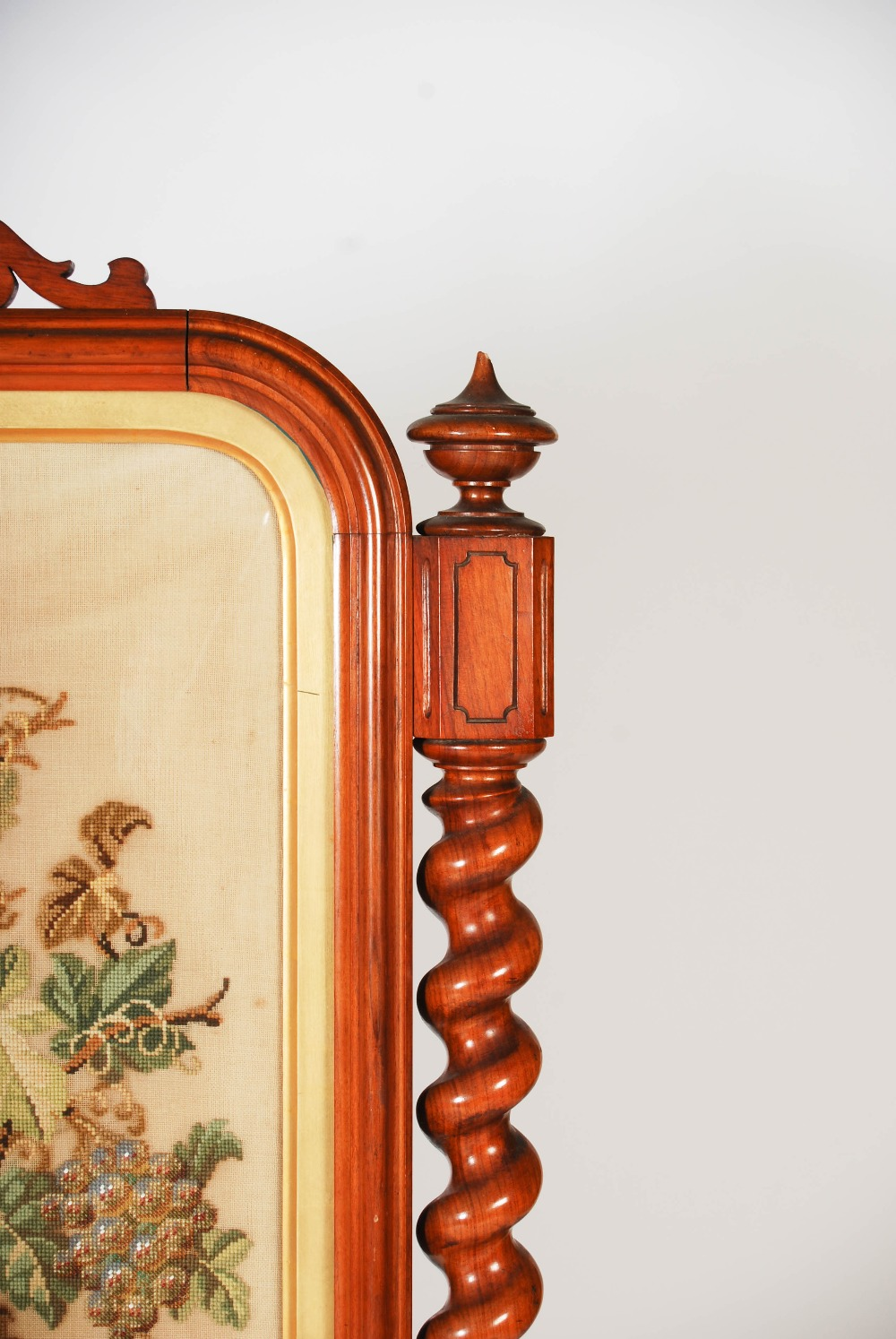 Lot 96 - A large Victorian mahogany needlework embroidered fire screen, the rectangular needlework panel