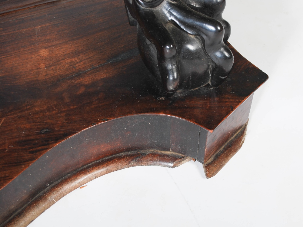 Lot 81 - An impressive Chinese dark wood bow front console table, Qing Dynasty, the shaped top with a mottled