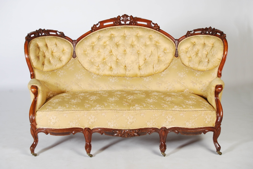 Lot 92 - A Victorian mahogany sofa, the top rail carved and pierced with flowers and foliage above a back