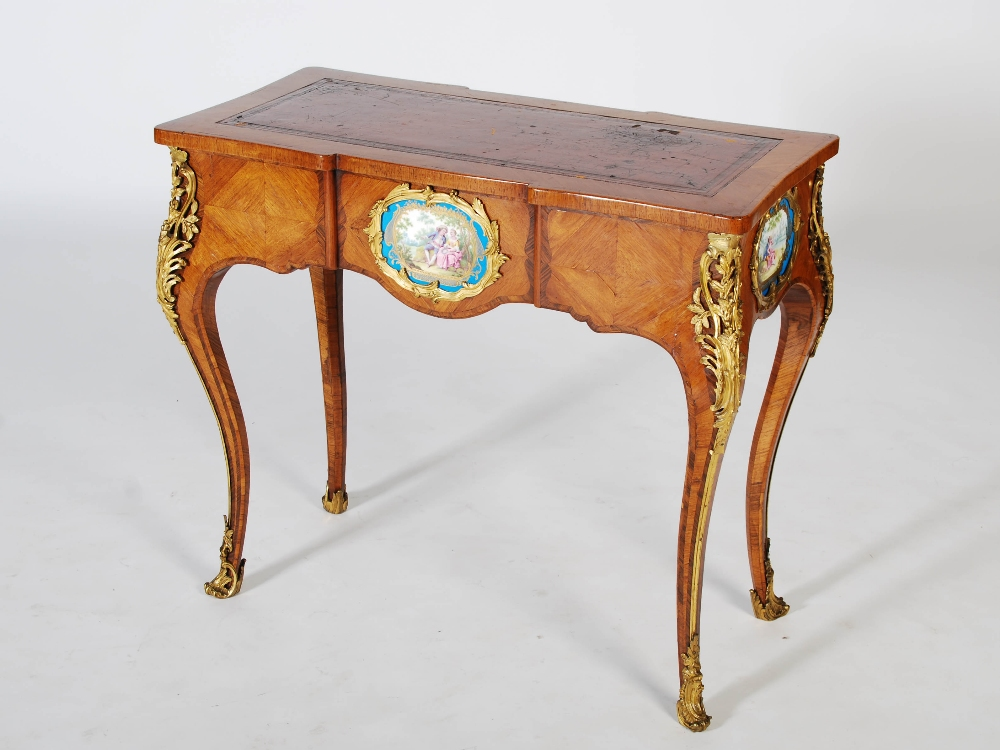 Lot 110 - A late 19th century kingwood, rosewood banded and ormolu mounted writing table, the shaped
