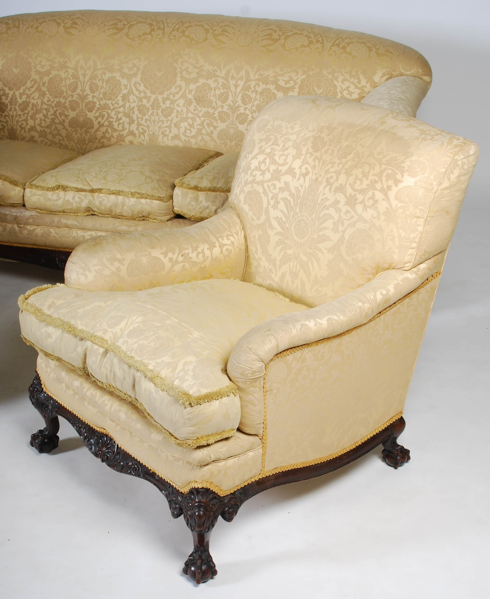 Lot 74 - A 20th century mahogany three piece suite, comprising; three seat sofa and two armchairs, all