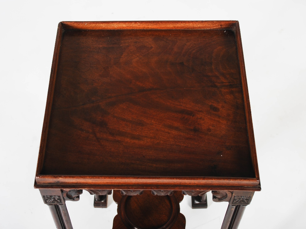 Lot 89 - A George III and later mahogany urn stand, the square top with raised gallery, raised on triple
