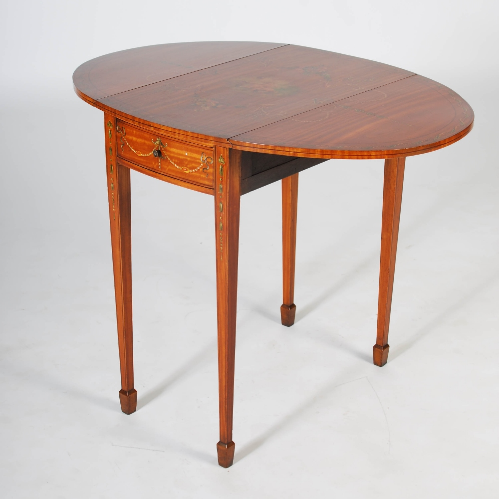 Lot 63 - An Edwardian painted satinwood Pembroke table, the oval top with twin drop leaves, painted with