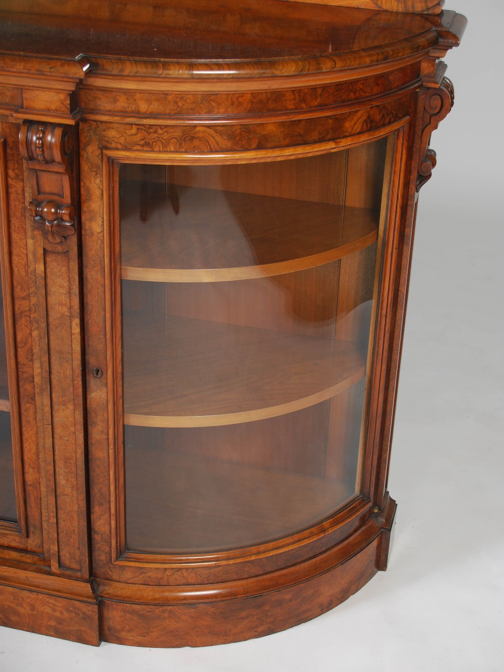 Lot 114 - A Victorian walnut mirror back credenza, the upright mirror back above a base fitted with a pair