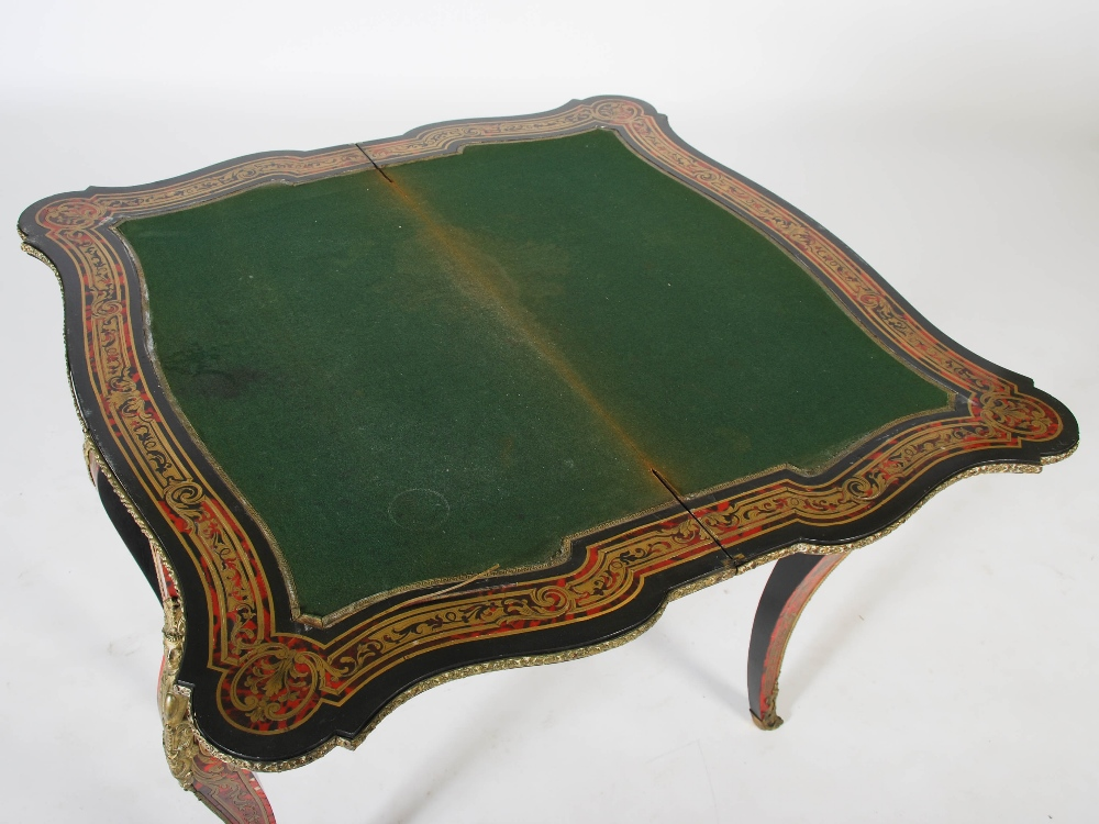 Lot 27 - A 19th century ebonised boulle work serpentine card table, the hinged top decorated with panel of