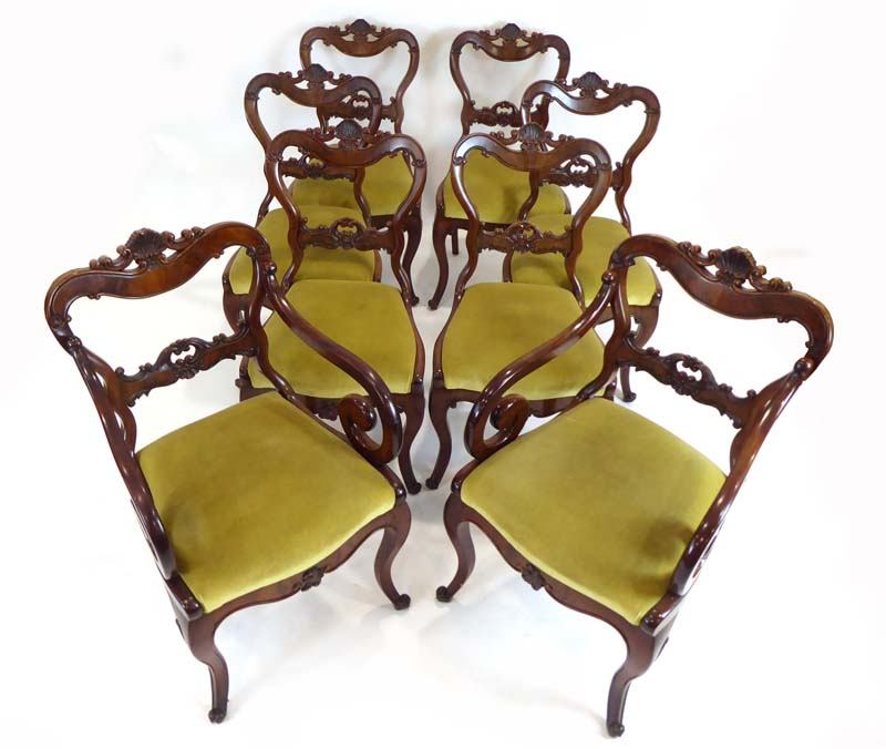 Lot 40 - A set of eight mahogany dining chairs with shell pediments over drop-in seats on cabriole legs,