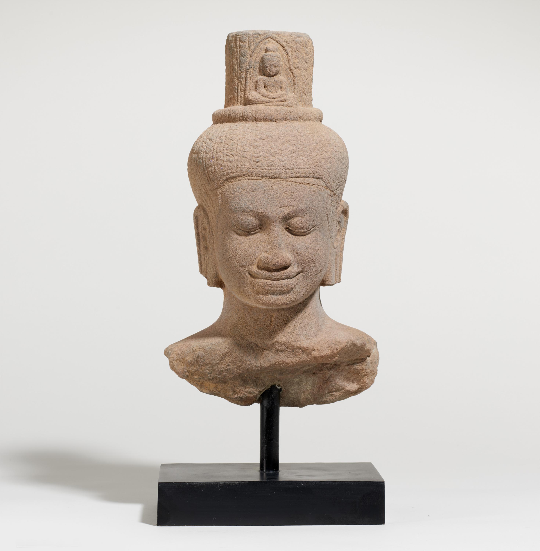 IMPORTANT BUST OF THE BODHISATTVA AVALOKITESHVARA. Origin: Khmer. Date: Late 12th c. Technique: - Image 2 of 5