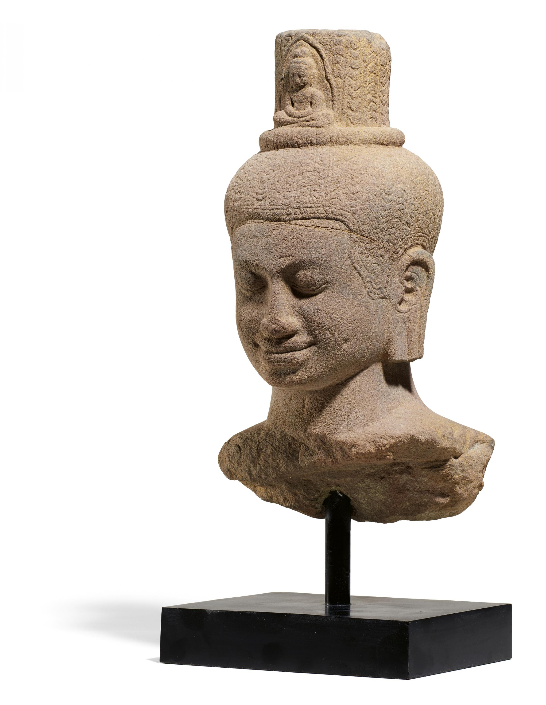 IMPORTANT BUST OF THE BODHISATTVA AVALOKITESHVARA. Origin: Khmer. Date: Late 12th c. Technique: