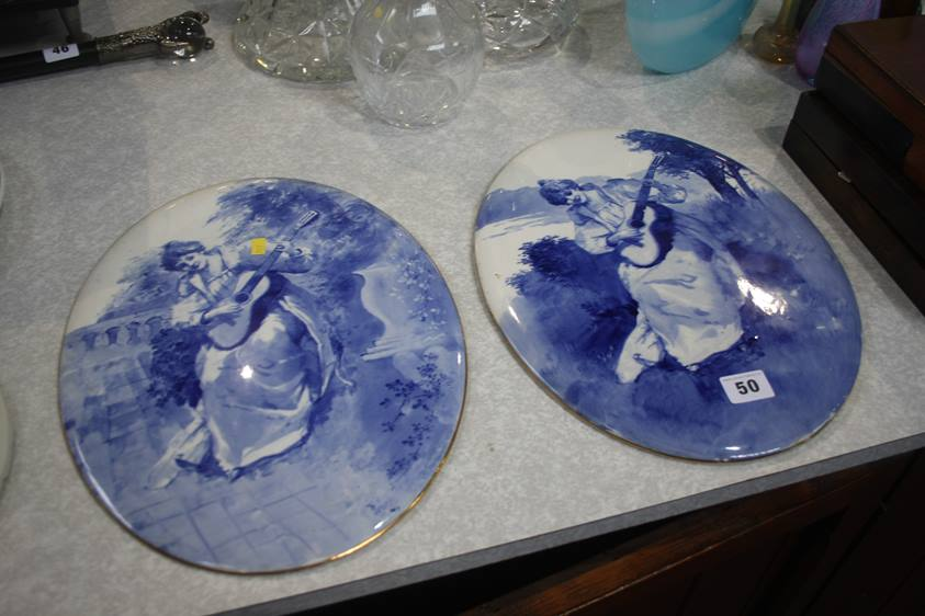 Lot 50 - A pair of blue and white oval plaques