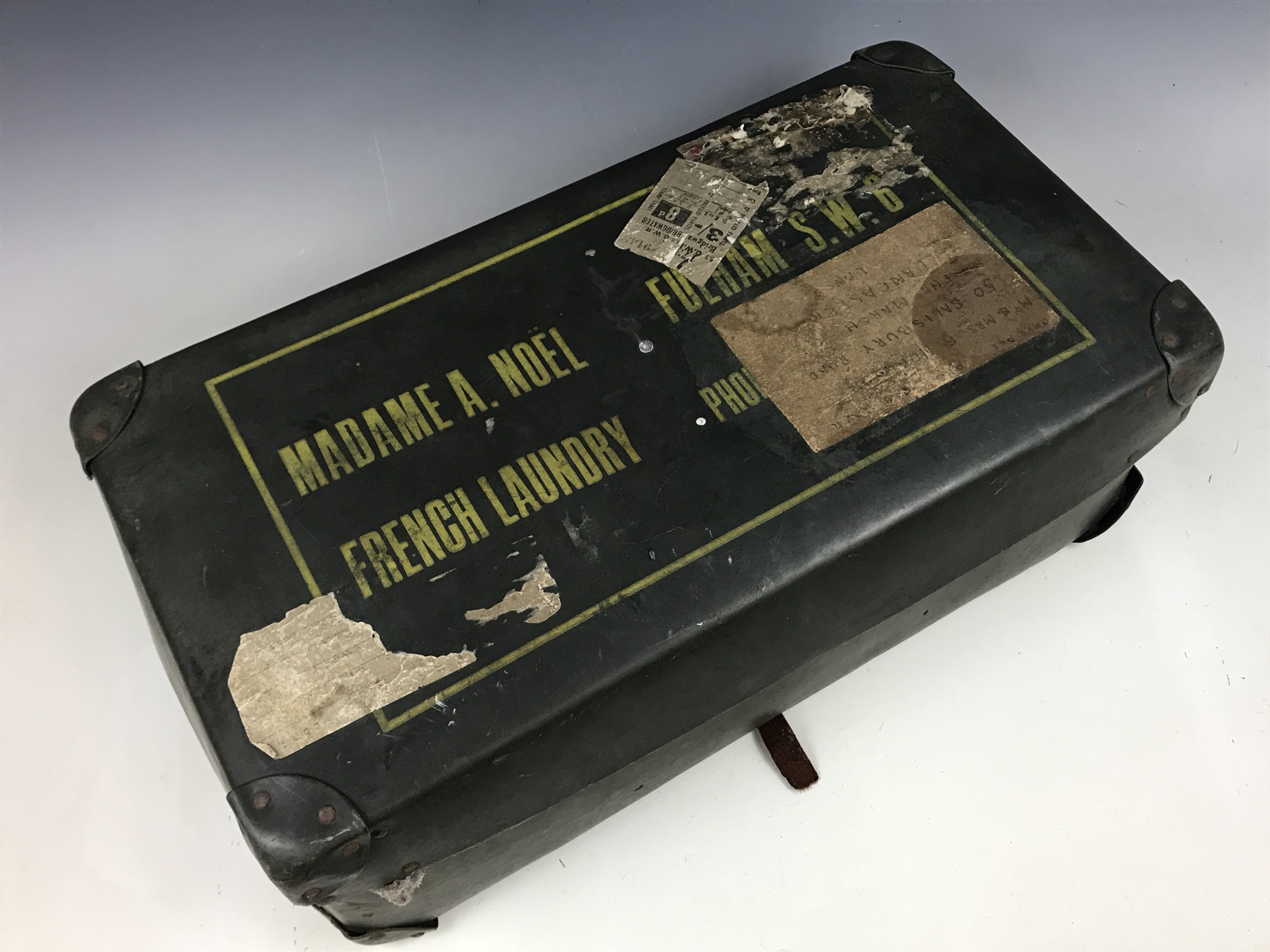 """Lot 3 - A vintage case bearing the address of """"Madame A. Noel, French Laundry, Fulham S.W.6"""" and a """"G.W.R"""