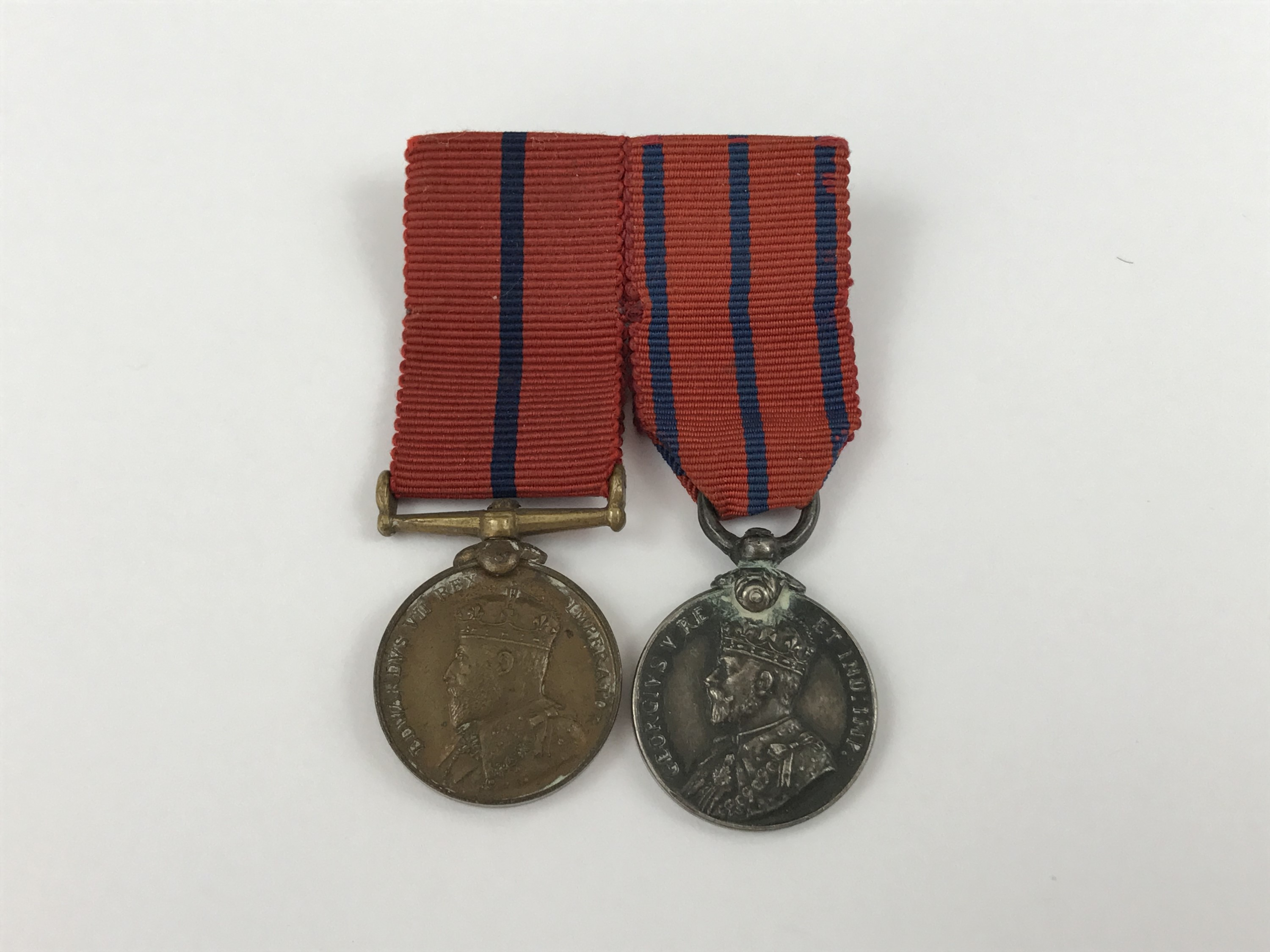 Lot 48 - A mounted pair of Metropolitan Police royal commemorative medal miniatures commemorating the