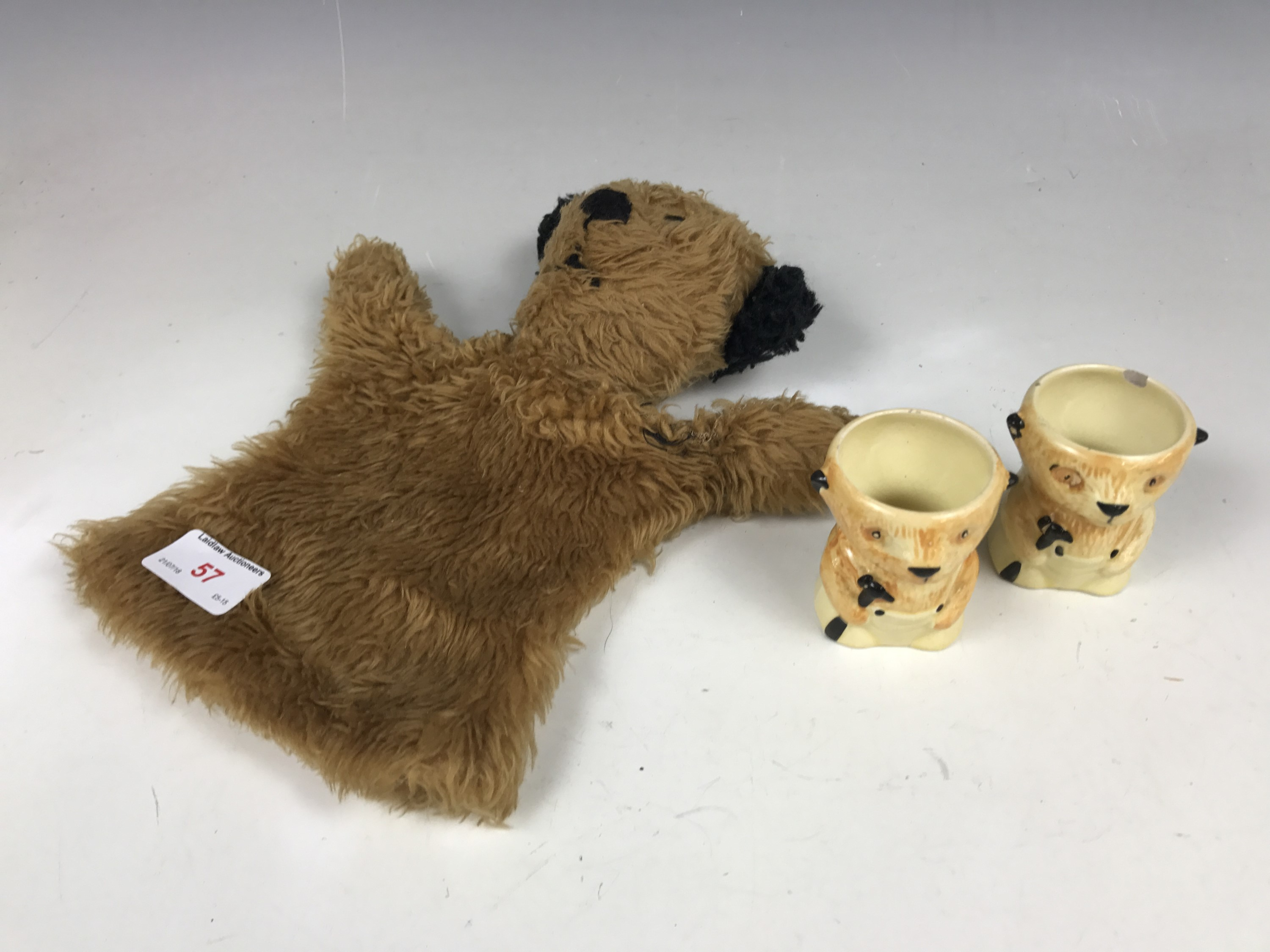 Lot 57 - A 1960s 'Sooty' glove puppet together with two Keele Street pottery egg cups