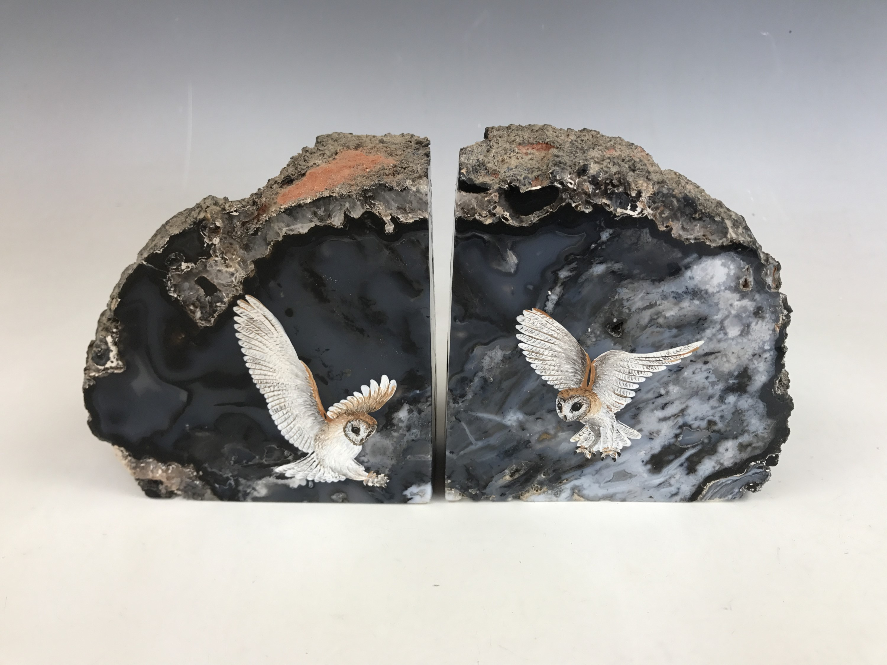 """Lot 9 - A pair of polished and hand-painted agate book ends entitled """"Barn Owls in Flight"""""""