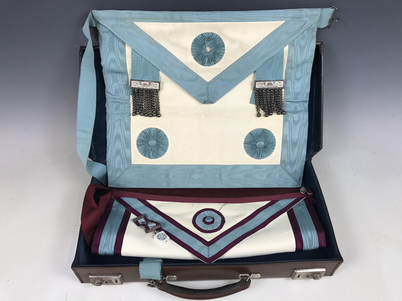 Lot 45 - A case containing Masonic regalia