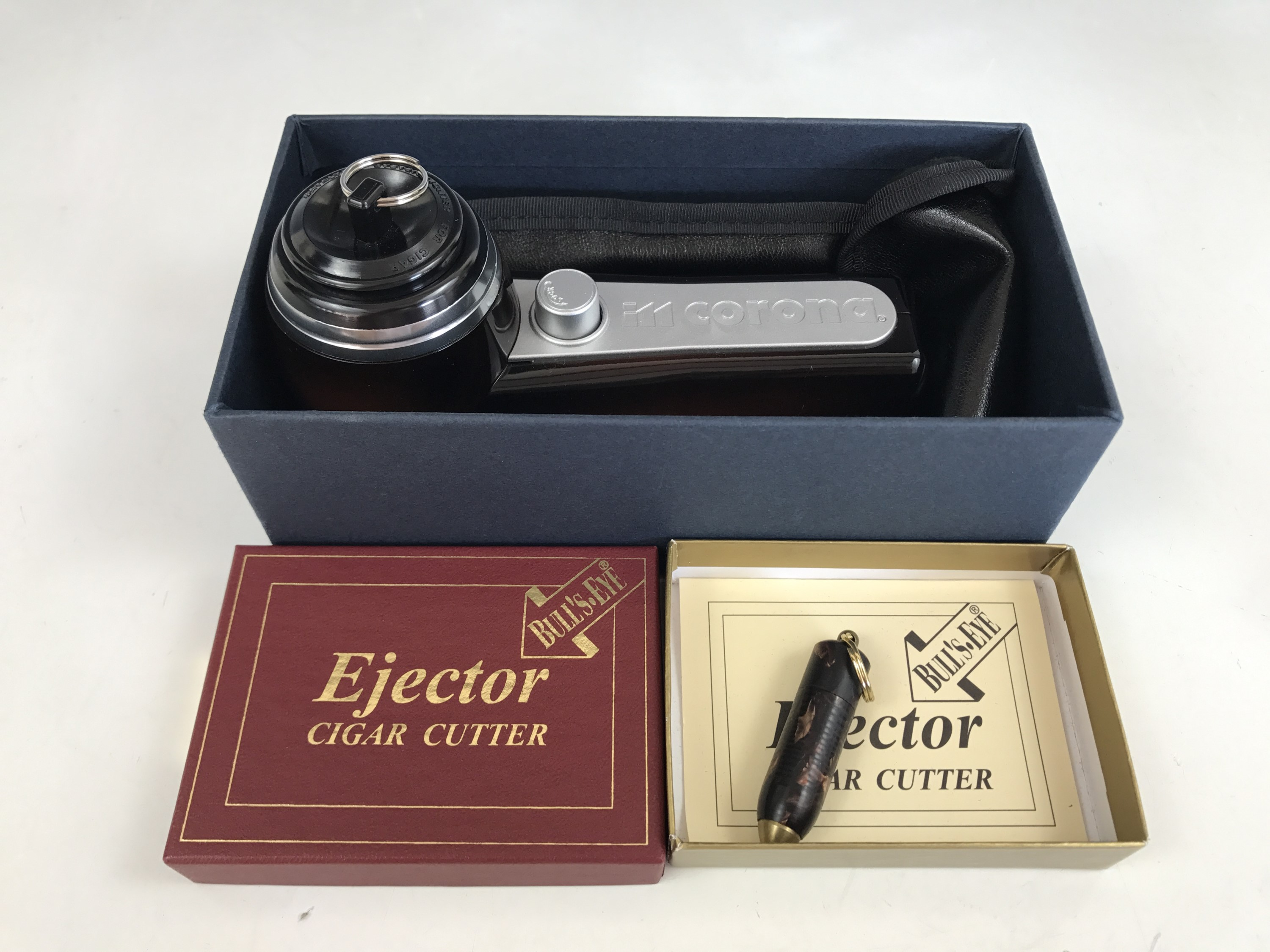 Lot 28 - A novelty Bull's Eye ejector cigar cutter, modelled in the form of a bullet, boxed, together with
