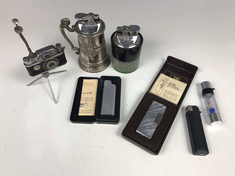 "Lot 19 - Seven various lighters including a ""Photo Flash"" novelty camera lighter"