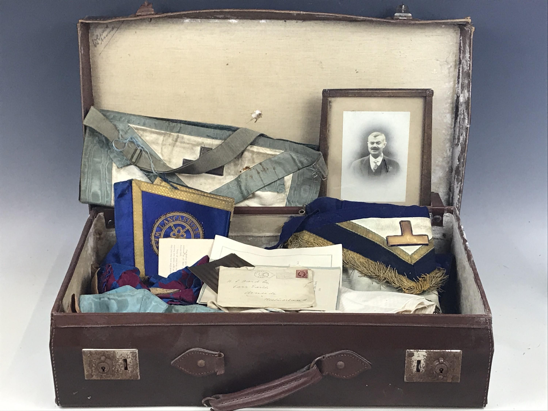 Lot 56 - A vintage travel case containing Masonic regalia