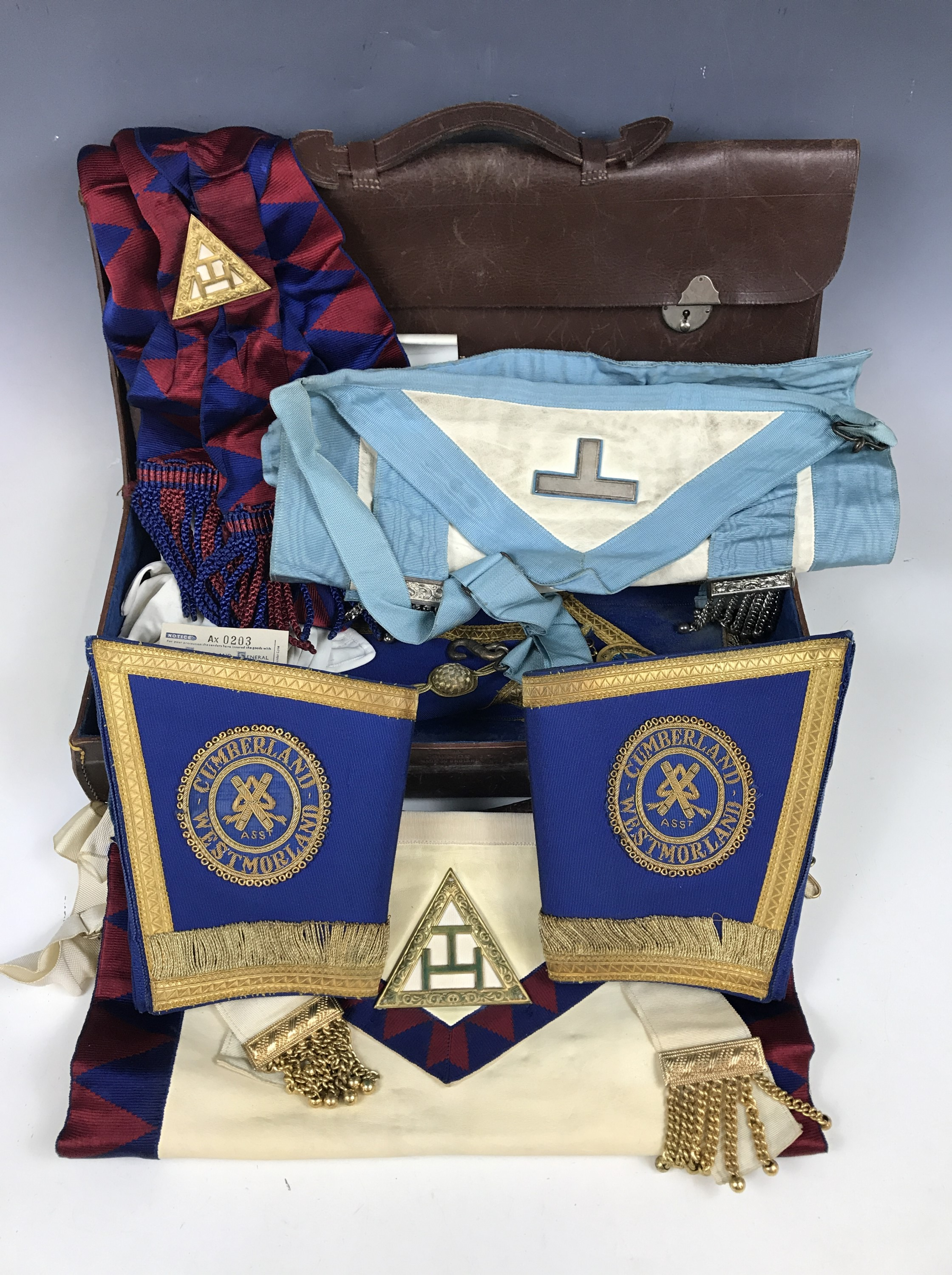 Lot 1 - A satchel and travel case containing Cumberland and Westmorland Masonic regalia