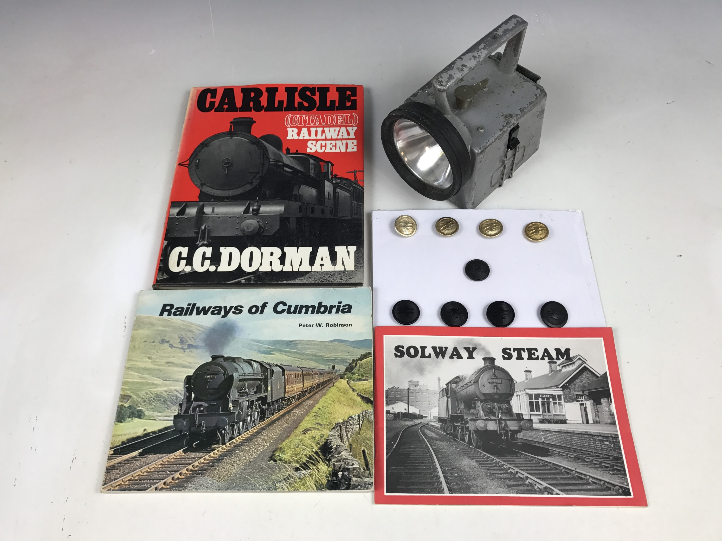 Lot 7 - A British Railways lamp together with buttons and three railway books