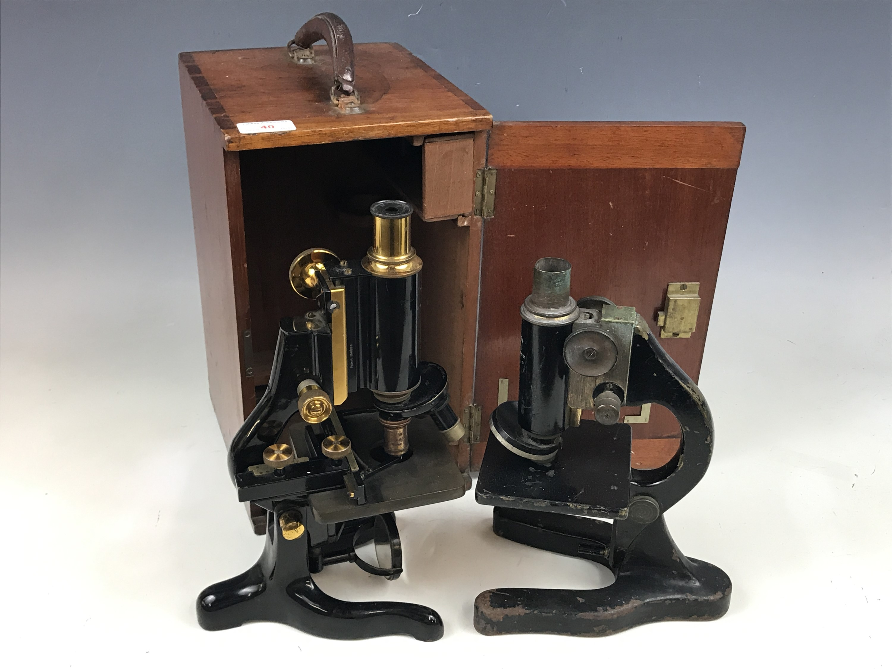 Lot 40 - A 1920s Watts' Service microscope, cased, together with one other (a/f) microscope