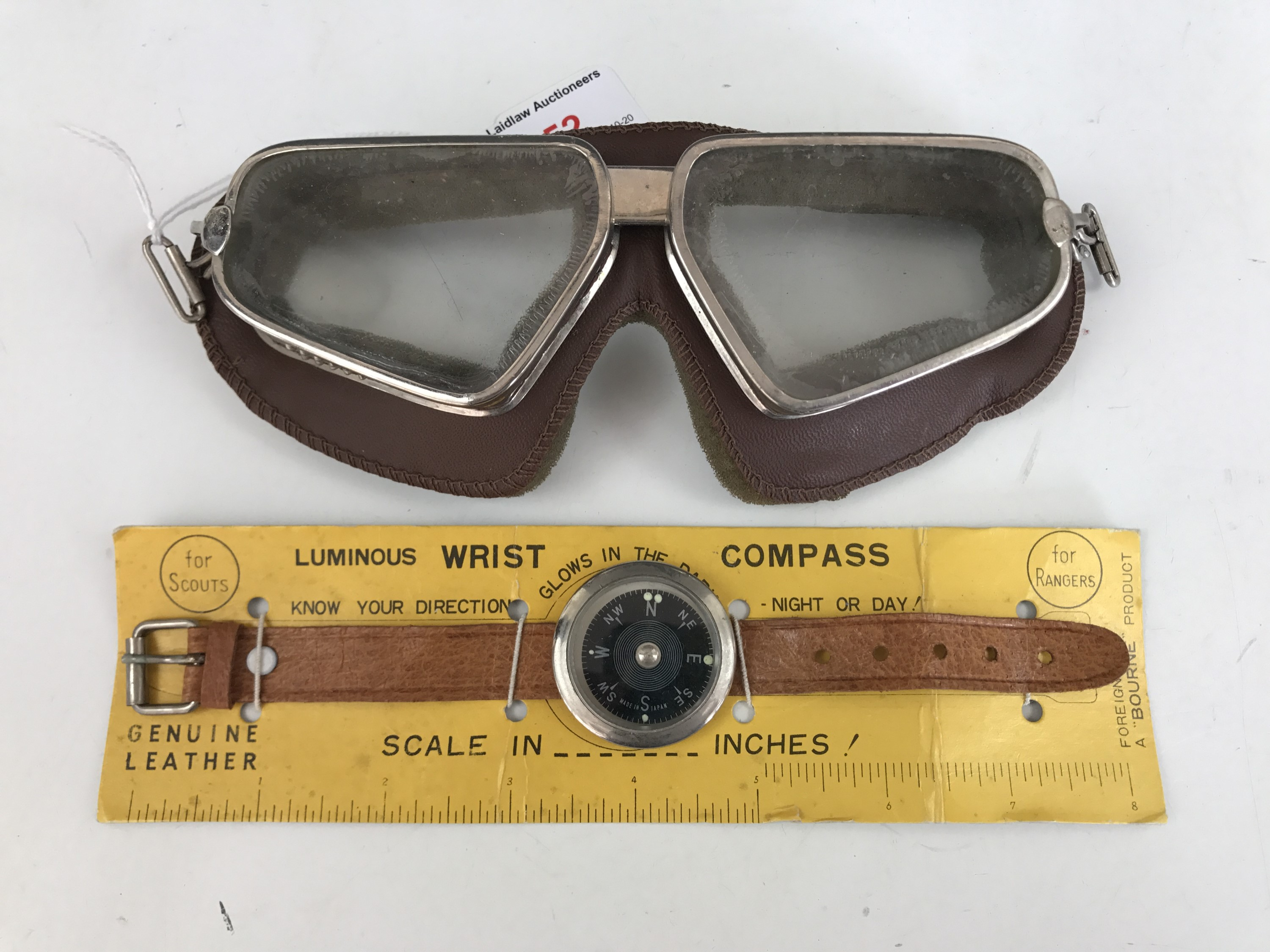 Lot 52 - A set of vintage flying / driving goggles and a luminous wrist compass on original packaging