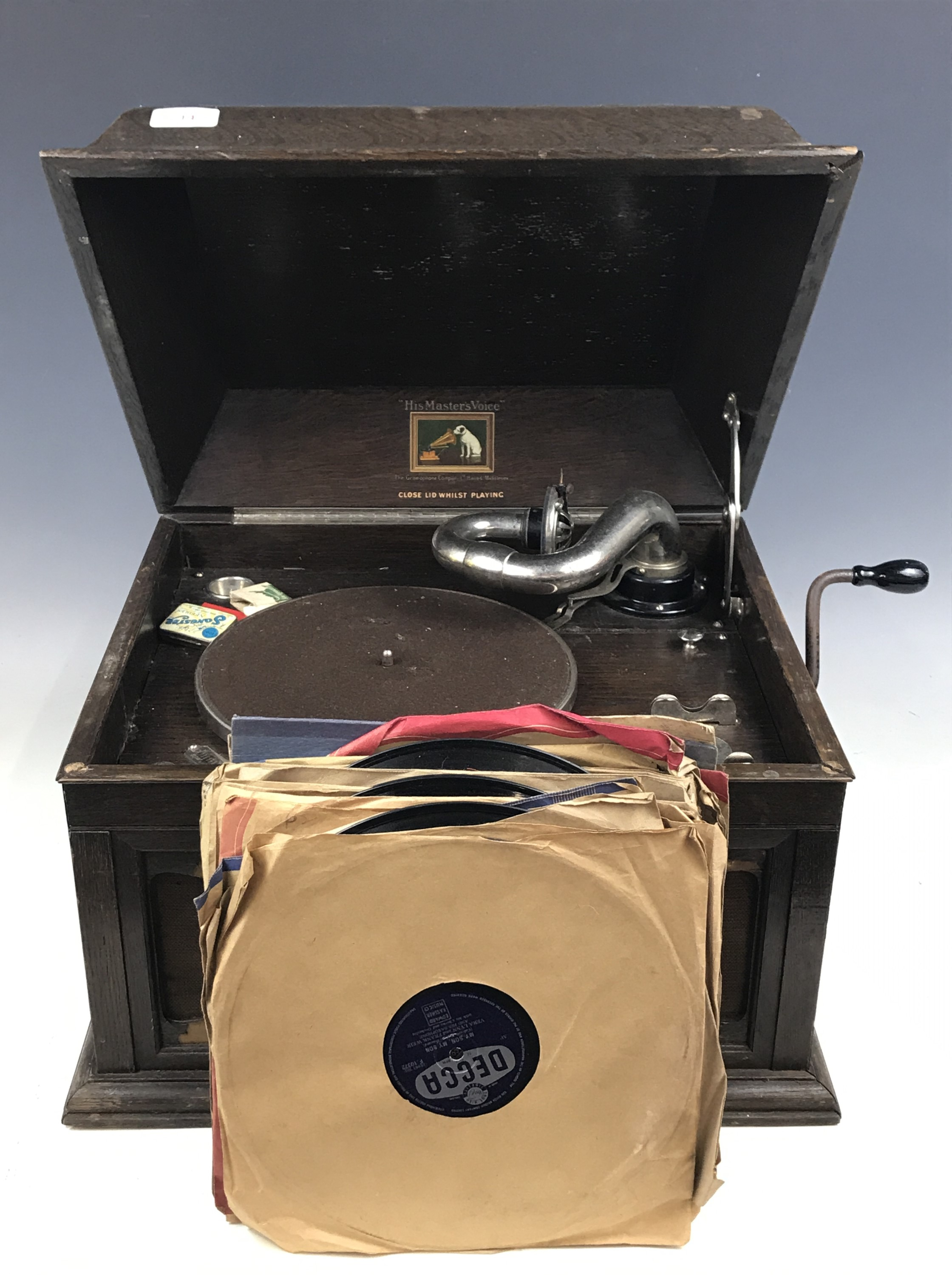 Lot 14 - A 'His Master's Voice' gramophone together with records