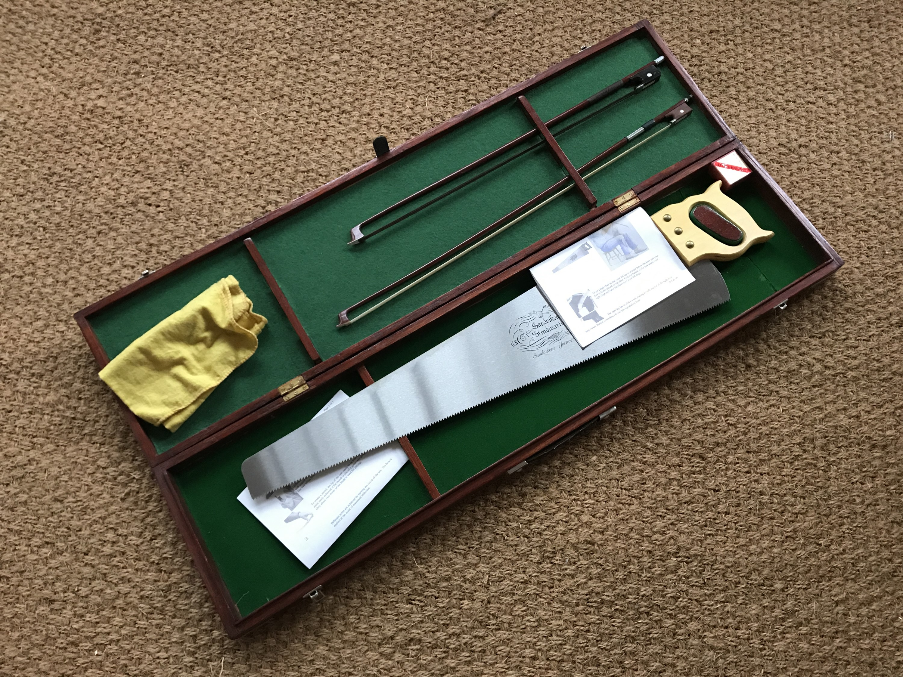Lot 41 - A cased Sandvik Stradivarius musical saw, with bows