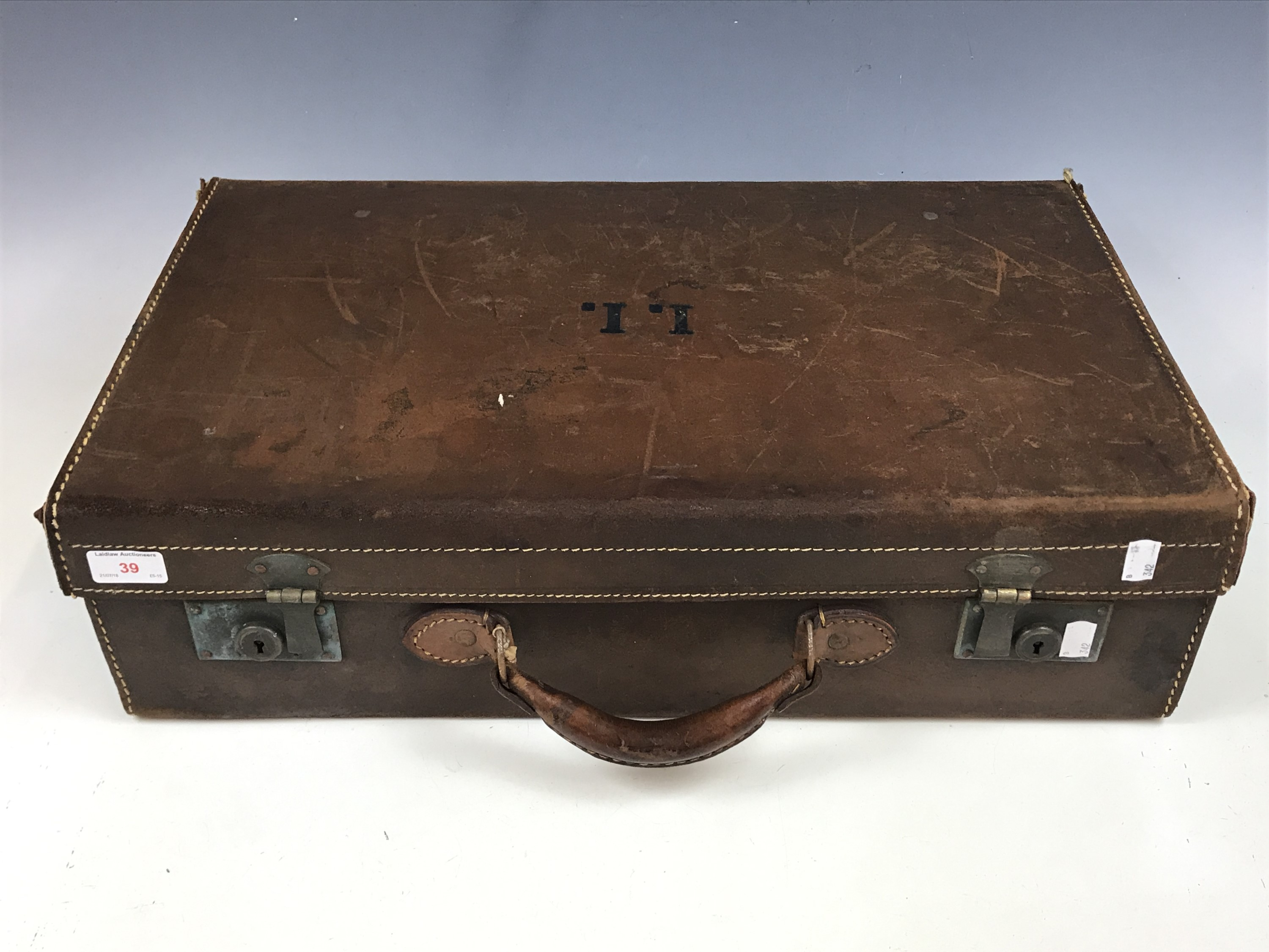 Lot 39 - A vintage hide suitcase
