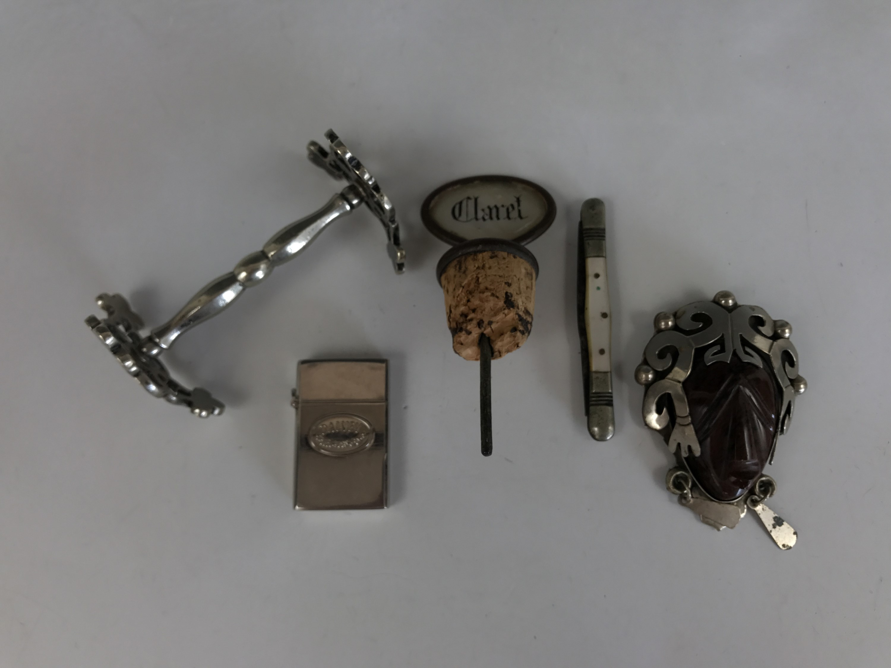 Lot 11 - Sundry collectors' items including a Victorian claret decanter stopper, an electroplate knife rest