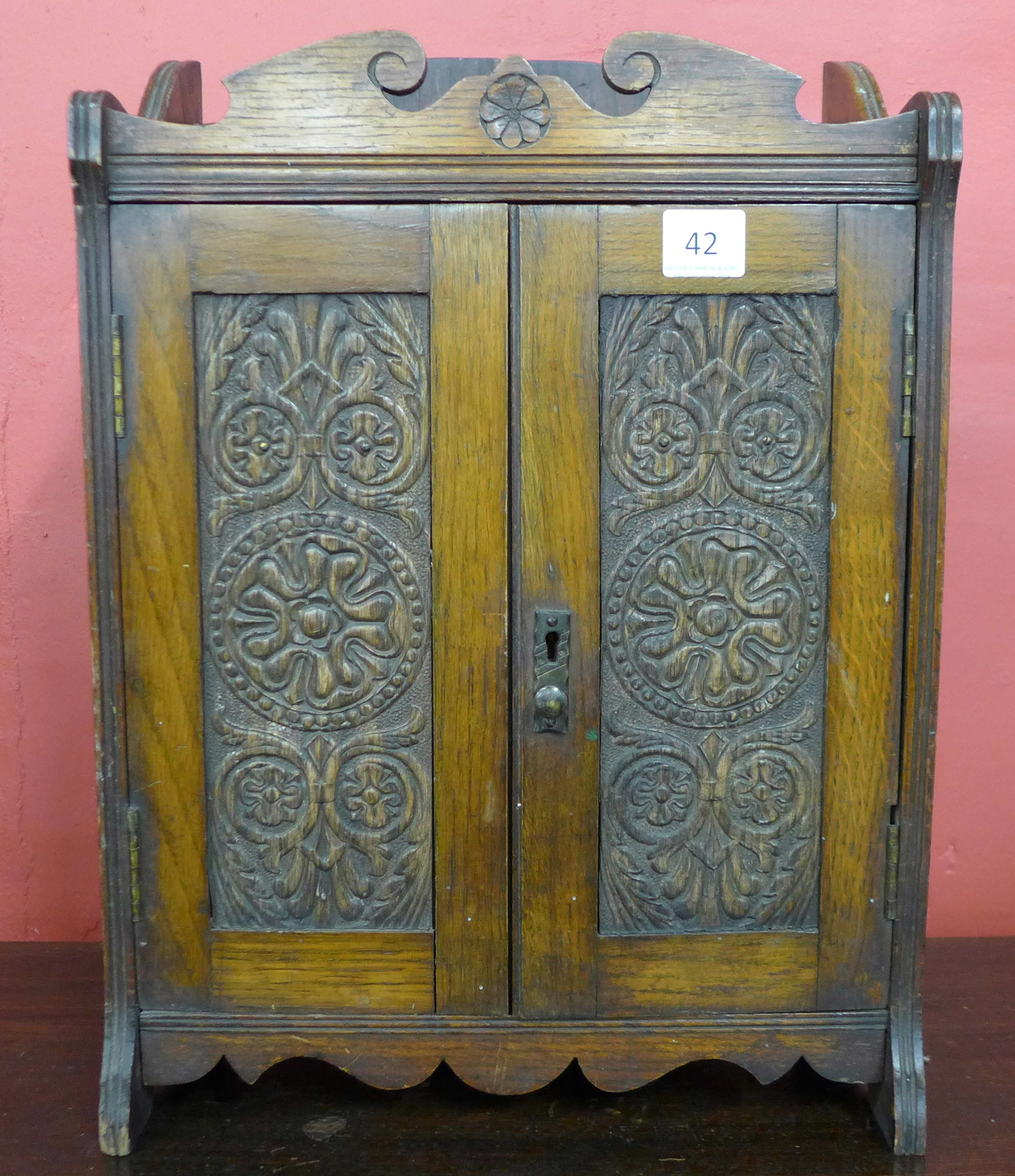Lot 42 - A Victorian carved oak smokers cabinet