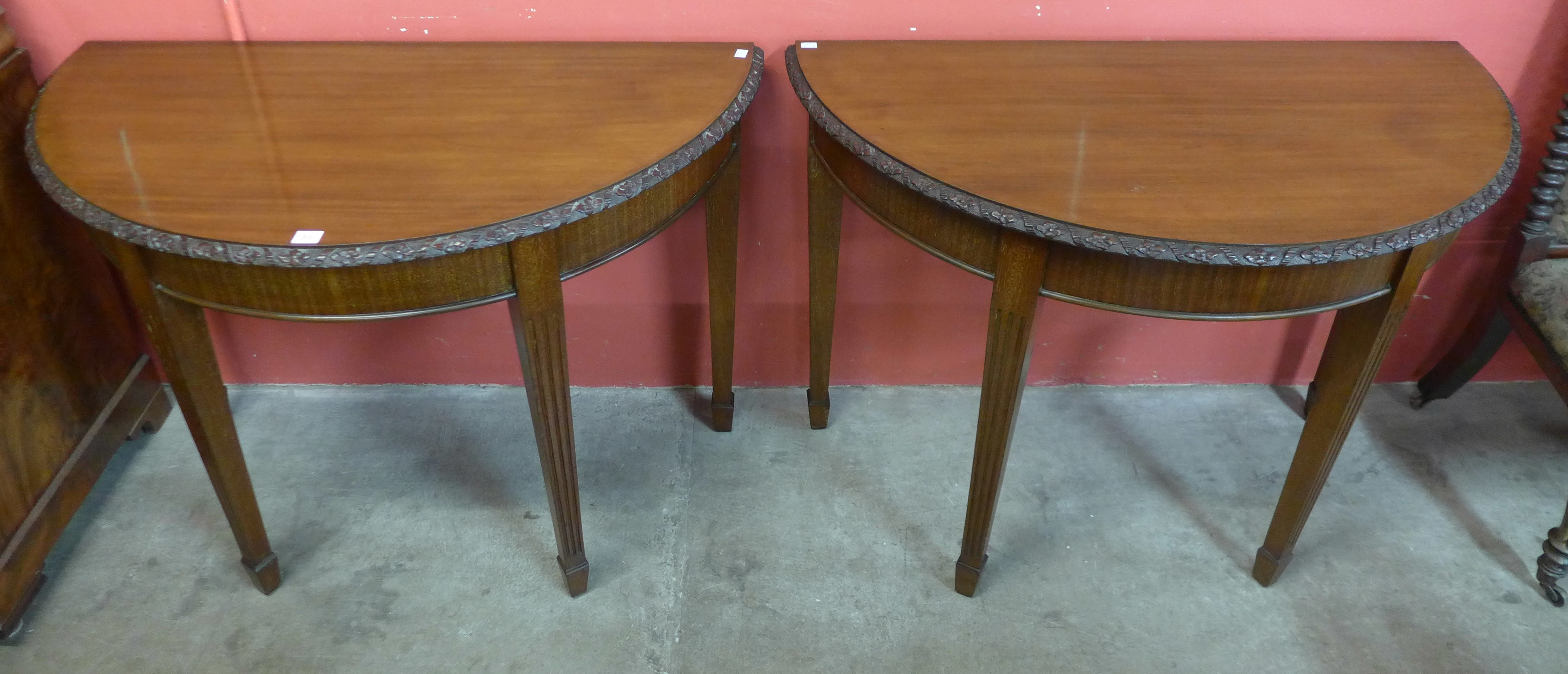 Lot 31 - A pair of Edward VII mahogany demi lune console tables