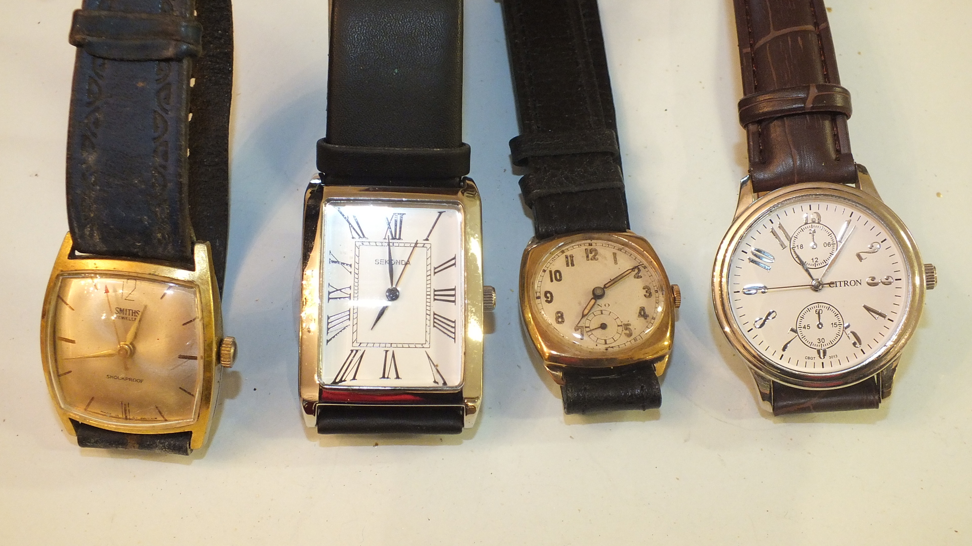 Lot 232 - A gent's 9ct gold cased wrist watch marked Uno and three other wrist watches.