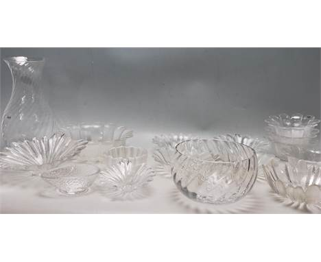 A collection of vintage Dartington crystal glass to include moulded daisy bowls, palm leaf bowls designed by Anita Harris, a