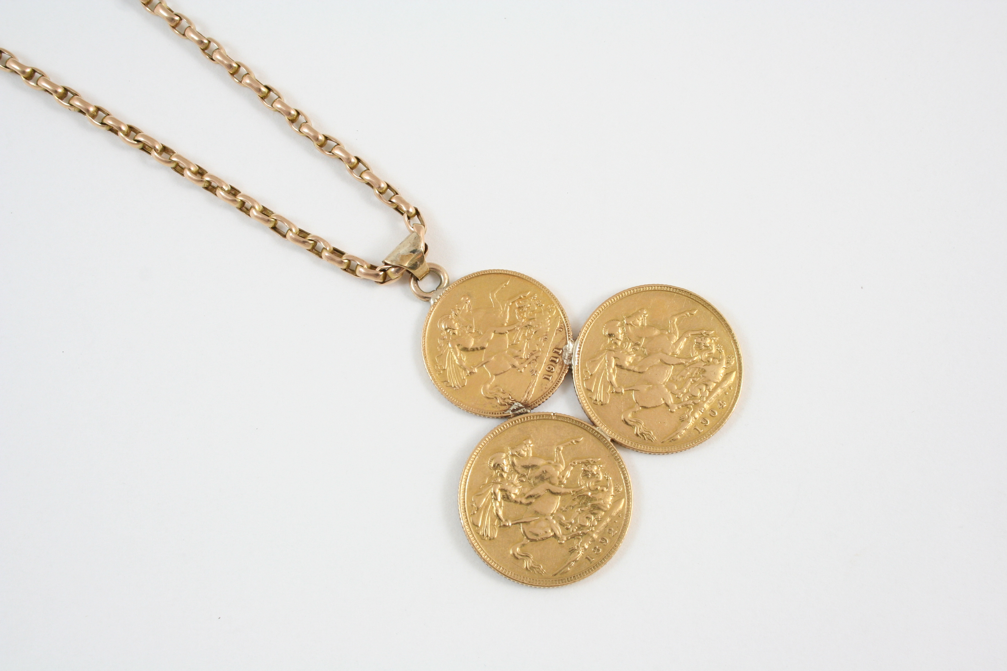 A gold sovereign pendant mounted with two sovereigns and one half lot 735 a gold sovereign pendant mounted with two sovereigns and one half sovereign aloadofball Images