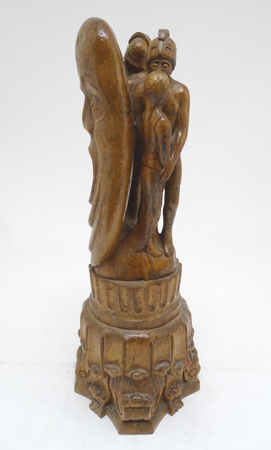 A 20thC carved wooden sculpture titled Tragic Muse to base, monogrammed TD and dated 1971 to side.