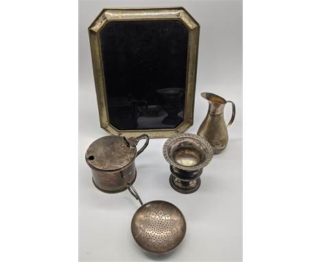 A collection of silver items to include an Italian photo frame, H.24cm, a Goldsmiths mustard pot with glass liner, hallmarked