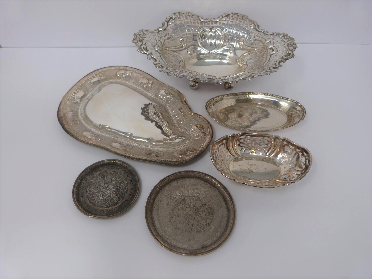 A collection of silver and white metal items including, trays and dishes, two pierced dishes one