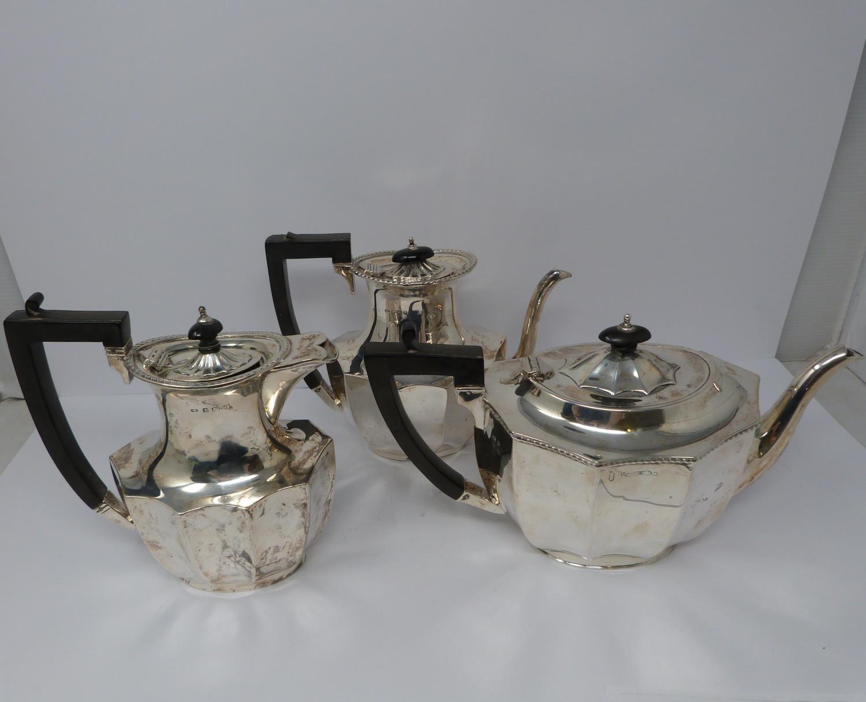 A 3 piece silver service; coffee pot, water jug and large tea pot, coffee pots William Devenport,