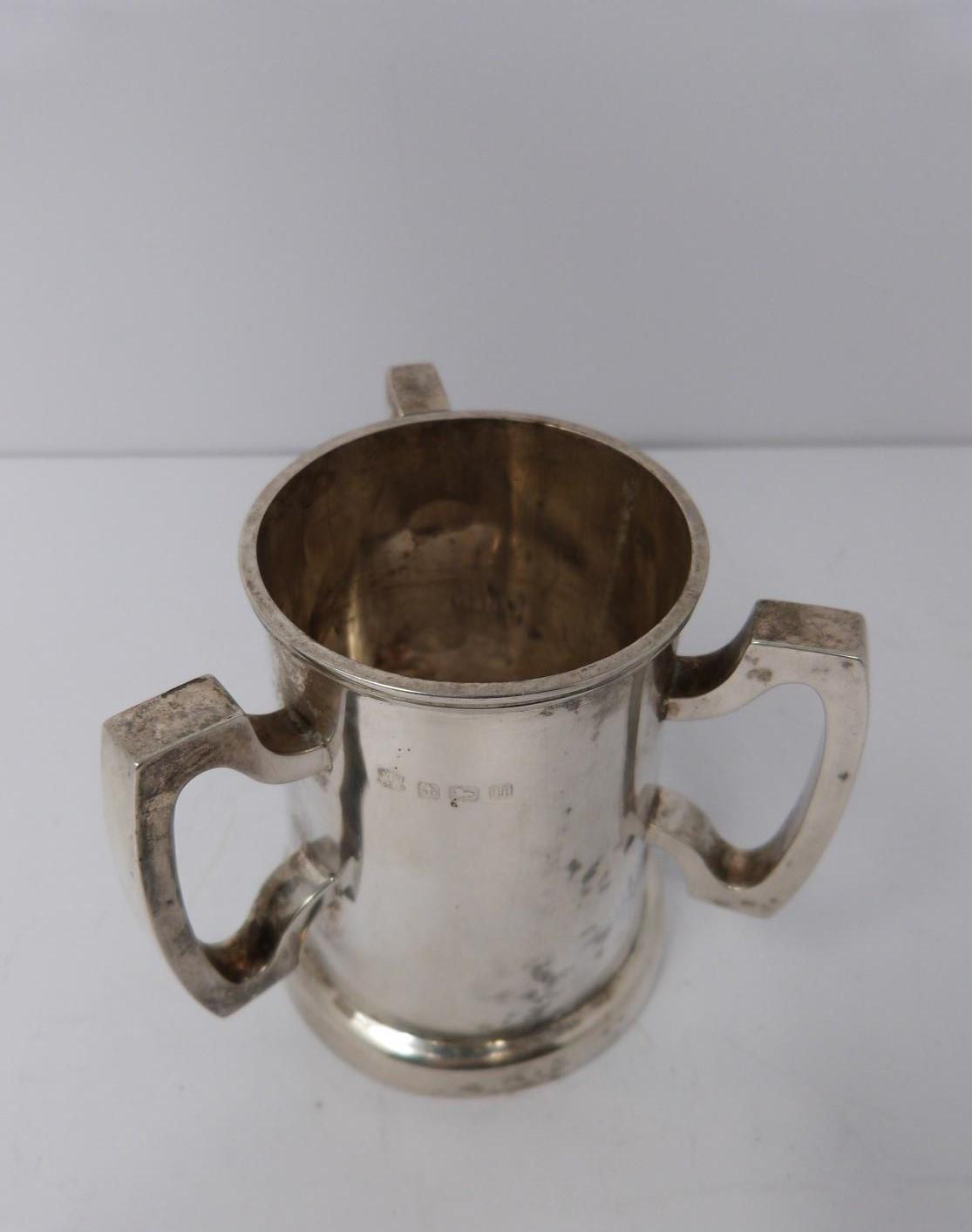 A three handled silver tyg/loving cup, Birmingham, 1919 by Martin Hall & Co Ltd. (119g).
