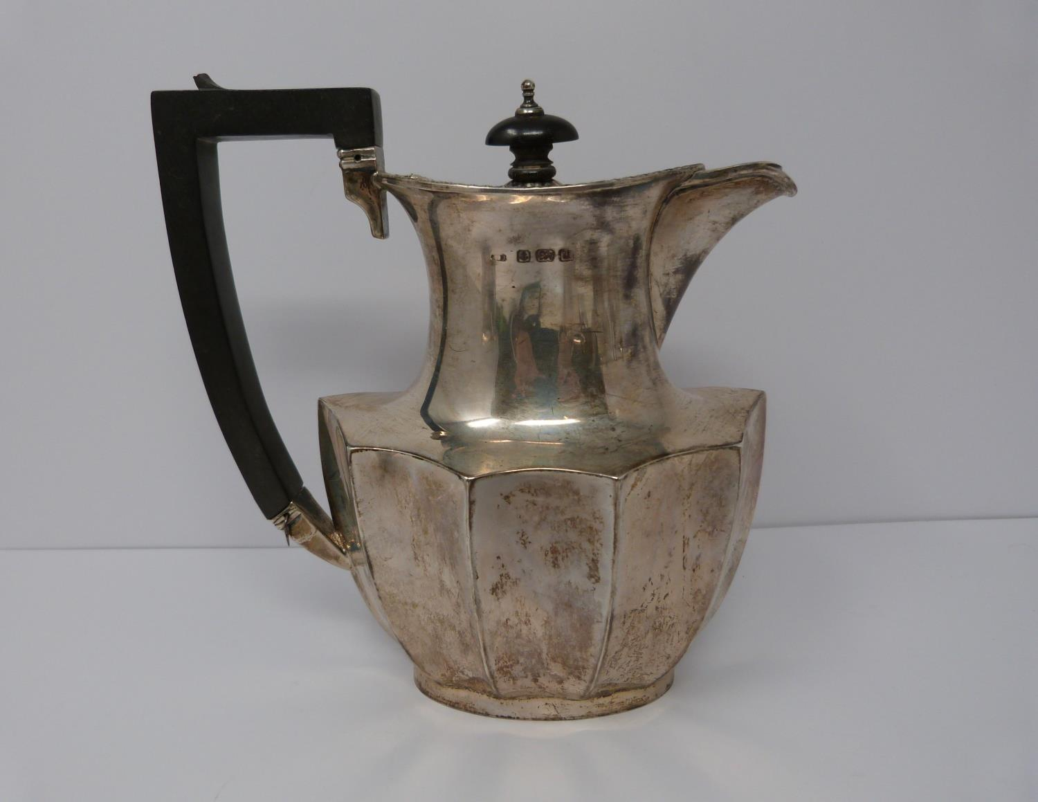 A silver six piece tea service with ebony handles and finial, coffee pot, tea pots, water jug, two - Image 3 of 10