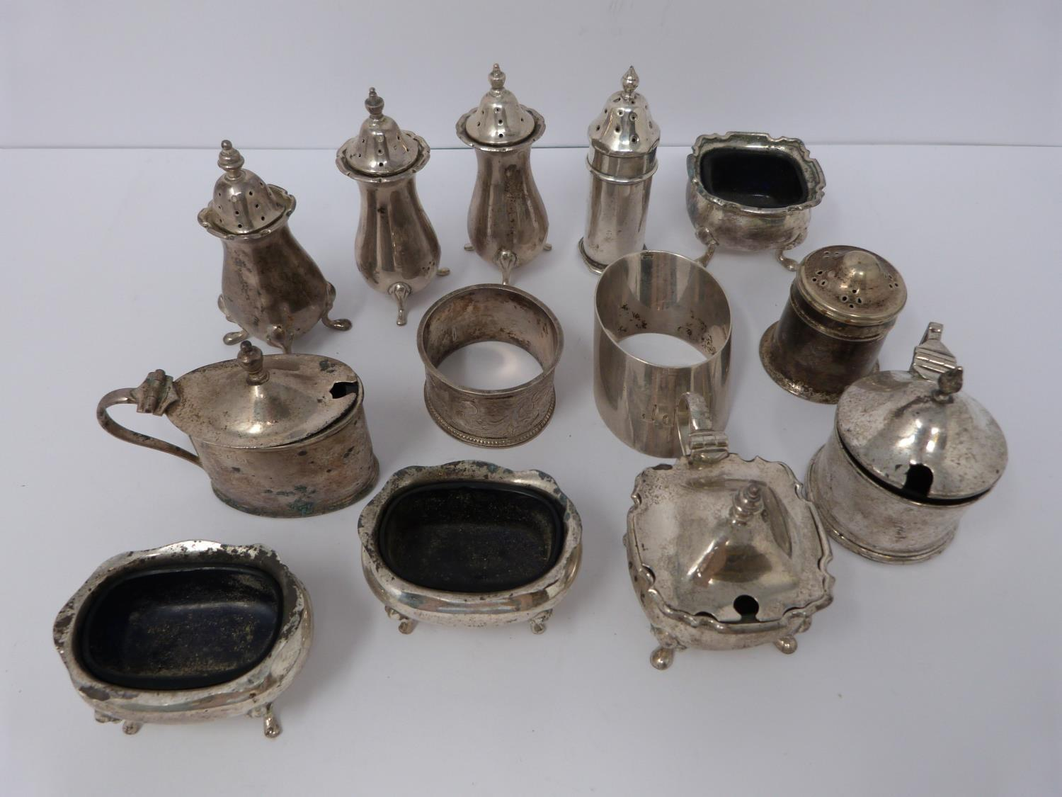 A collection of silver cruets and two silver napkin rings, Elkington and Co, Birmingham,