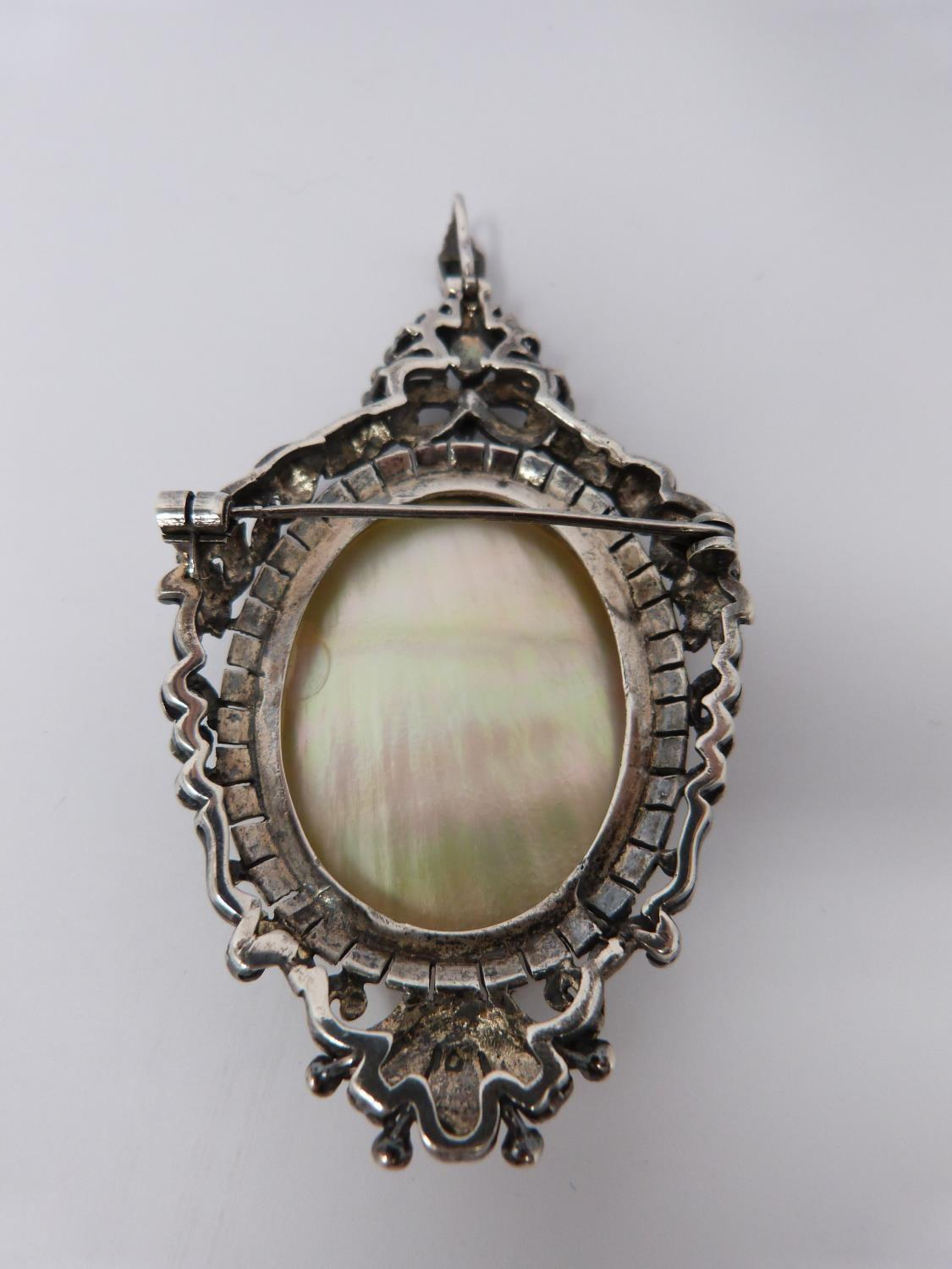 A silver mother of pearl cameo brooch/pendant with Marcasite stones with four other vintage - Image 4 of 6