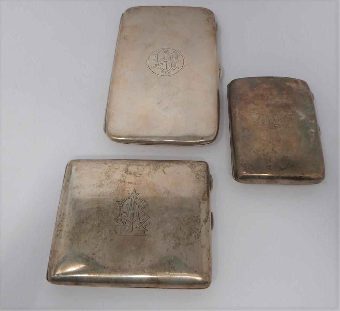 Three monogrammed silver cigarette cases, large case, birmingham 1920, Charles S Green & Co Ltd.
