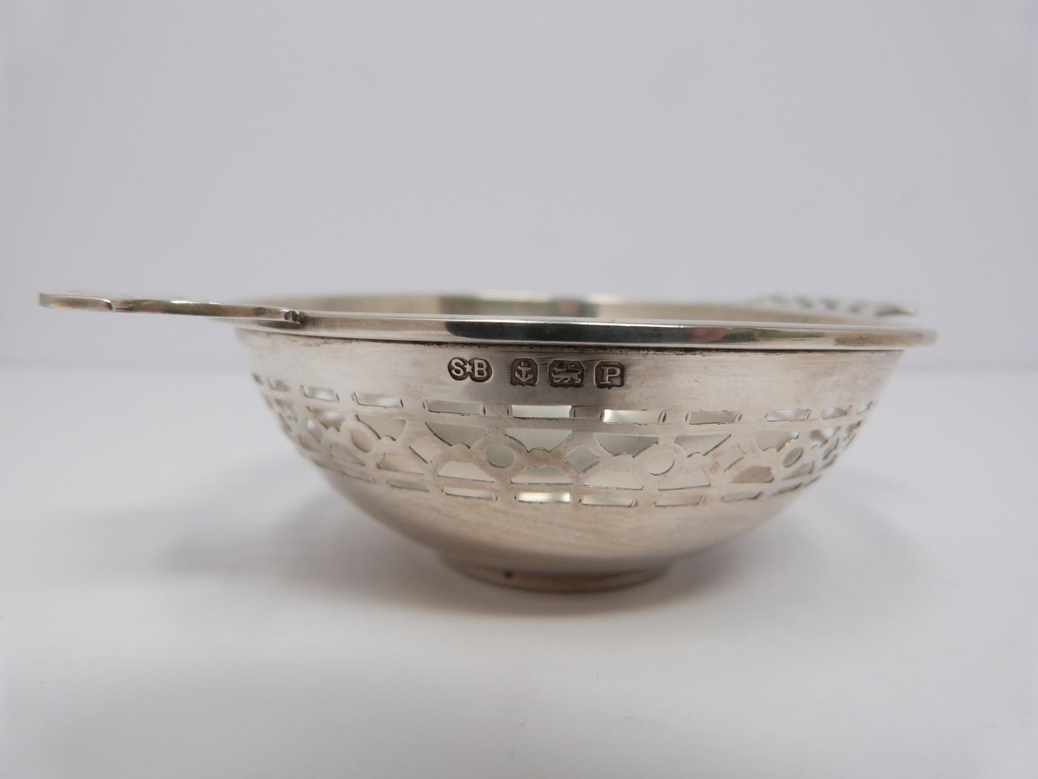 Two silver and cut glass sugar sifters, two silver pierced dishes and a silver engraved napkin ring, - Image 6 of 7