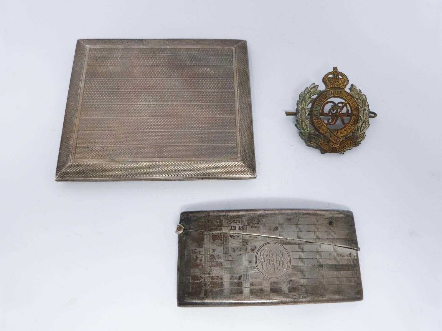Two silver cigarette cases and a Royal engineer hat badge, one gilded inside, Birmingham, 1925,