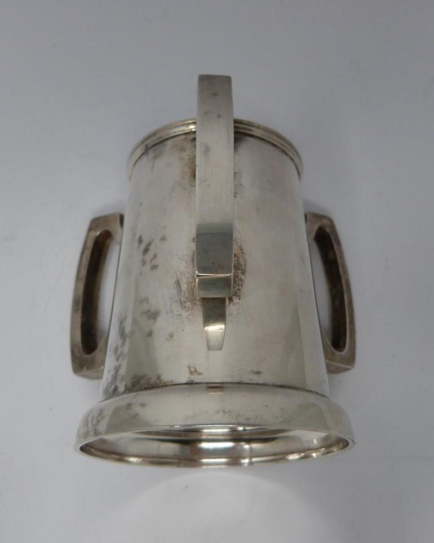 A three handled silver tyg/loving cup, Birmingham, 1919 by Martin Hall & Co Ltd. (119g). - Image 4 of 5
