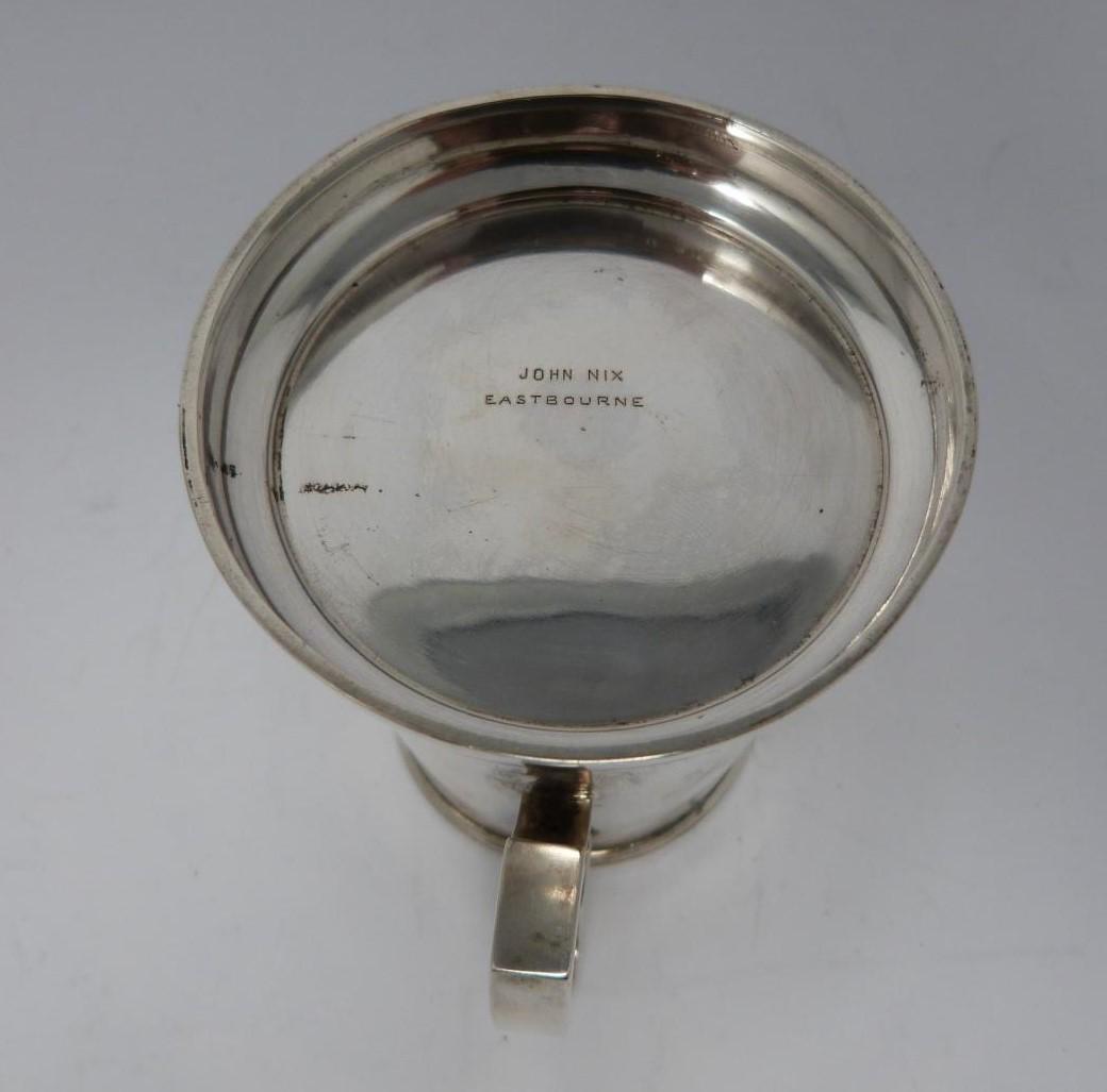 A three handled silver tyg/loving cup, Birmingham, 1919 by Martin Hall & Co Ltd. (119g). - Image 5 of 5
