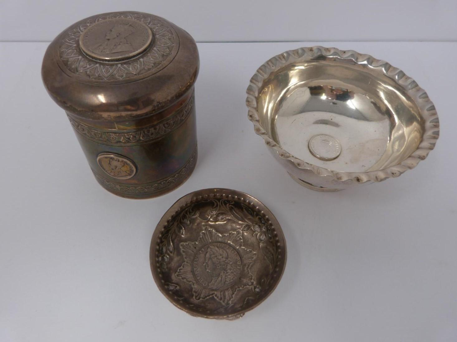 A collection of white metal dishes and a box decorated with coins and a silver and horn twist handle
